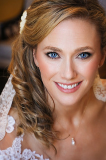 Photograph of Bride with makeup by Katrina Hess on her wedding day